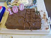 foto of centenarian  - birthday cake with candles shaped in 100 - JPG