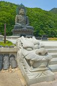 foto of seoraksan  - Giant statue of Buddha and memorial plates in the Sinheungsa Temple in Seoraksan National Park - JPG