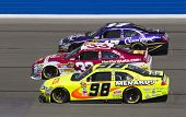 FONTANA, CA - OCT 10:  Clint Bowyer, Matt Kenseth and Paul Menard fight for position during the Peps