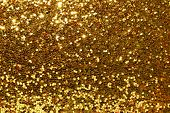 foto of gold glitter  - Glittering gold background - JPG