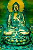 pic of budha  - The Budha sitting on a lotus flower while passing a blessing - JPG