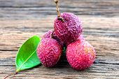 Lychee Fruit On Wooden Background poster