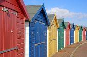 Beach Huts On Dawlish Warren Beach, Devon poster