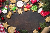 Christmas Gingerbread With Christmas Decorations On Dark Stone Background. Christmas Baking Backgrou poster
