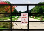 picture of soliciting  - No soliciting sign in front of gated community - JPG