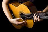 pic of potentiometer  - Closeup view of playing classic spanish guitar - JPG
