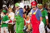 Nintendo fans dressed as game characters march in the annual DragonCon parade