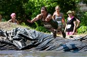 Woman Dives Into Mud Pit On Obstacle Course Run