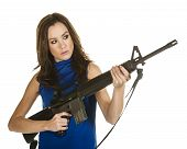 picture of ar-15  - A young woman in a blue blouse holding an assault rifle - JPG