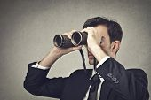 image of binoculars  - young businessman looking with binoculars - JPG