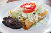 picture of enchiladas  - Enchiladas with cheese and beans in a mexican restaurant  - JPG