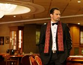 image of gambler  - Handsome brunette wearing suit in luxury interior - JPG