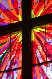 picture of christian cross  - A portion of a stained glass window with wooden molding forming a Christian cross - JPG
