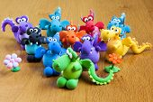stock photo of molding clay  - multicolored set of handmade toy dragons made with modelling clay - JPG
