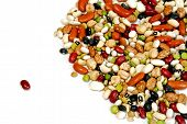 stock photo of legume  - a single bean stands isolated from an assortment of other beans - JPG