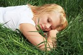 Attractive young woman taking a nap outside on a sunny day.