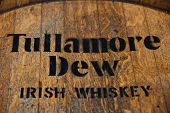 DUSSELDORF, GERMANY - SEPTEMBER 4, 2013: Tullamore Dew Irish whiskey brandmark on rustic whiskey jar