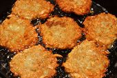 image of frizzle  - potato pancakes frizzle in black frying pan - JPG