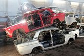 picture of scrap-iron  - heap of cars is returned for recycling as scrap metal - JPG