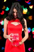 image of boxing day  - Beautiful woman opening a holiday gift or present - JPG