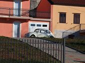 picture of beetle car  - retro car in front of family house - JPG