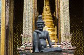 image of hermit  - statue of hermit located in front of temple wat phra keaw Bangkok Thailand - JPG