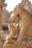 picture of kandariya mahadeva temple  - Lion and young woman statues at Kandariya Mahadeva Temple at Khajuraho in India Asia - JPG