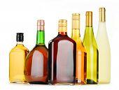 pic of ethanol  - Bottles of assorted alcoholic beverages isolated on white background - JPG