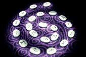 pic of rune  - Runes illuminated in a spiral pattern purple background - JPG