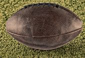 stock photo of pro-life  - Leather football over a green grass field hdr image - JPG