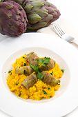 image of artichoke hearts  - a dish with Italian risotto with artichok  - JPG