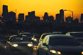stock photo of nightfall  - Traffic at nightfall in city with Miami Skyline on background - JPG