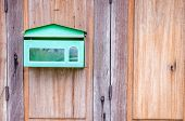 image of postbox  - Postbox in front of retro wooden door - JPG