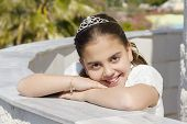 stock photo of communion  - A young girl celebrating her First Holy Communion  - JPG