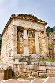 image of treasury  - The reconstructed Athenian Treasury built to commemorate their victory at the Battle of Marathon Delphi Greece.