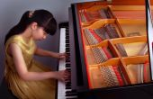 stock photo of grand piano  - a young girl was playing baby grand piano - JPG