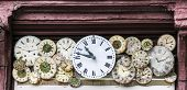 stock photo of exposition  - Watchmaker exposition with old clock shields - JPG