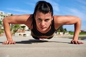 picture of strength  - determination pushup woman for fitness and strength training - JPG