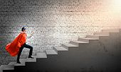 picture of superman  - Young superman walking up the stair case - JPG