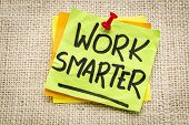 stock photo of canvas  - work smarter reminder on a green sticky note against burlap canvas - JPG