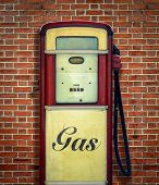 pic of gasoline station  - Retro Vintage Americana Gas Station Pump Against Red Brick Wall