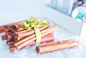 stock photo of desert christmas  - cinnamon sticks for christmas baking on a table - JPG