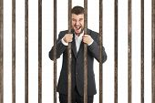 picture of scream  - angry screaming businessman behind the prison cell over white background - JPG