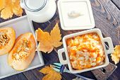 foto of porridge  - pumpkin porridge in the bowl and on a table - JPG