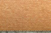 stock photo of foundation  - Somewhat clean exterior brick wall with a rather dirty concrete foundation - JPG