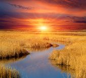 pic of steppes  - Sunset scene over small lake in steppe - JPG