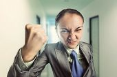 image of nervous breakdown  - Angry irritated woman in the office - JPG