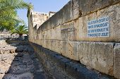 stock photo of synagogue  - The white stones of the synagogue in Capernaum are built upon the original black remains from the time of Jesus - JPG