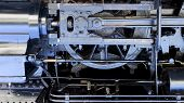 image of steam  - steam punk style engine mechanical background with flywheel - JPG