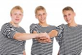 picture of conscript  - Young men in striped shirts in friendship joined his hands - JPG